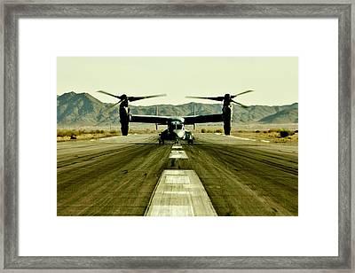 Osprey Takeoff Framed Print by Benjamin Yeager