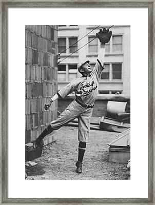 Outfielder Challenges Framed Print by Underwood Archives