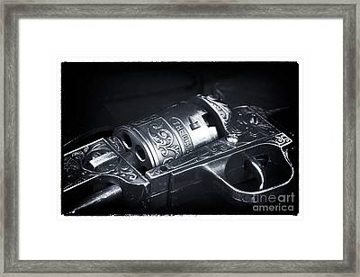 Outlaw Revolver Framed Print by John Rizzuto