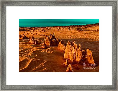 Over Ten Thousand Years Ago Framed Print by Julian Cook