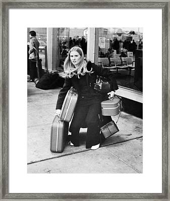 Overloaded Airline Traveler Framed Print by Underwood Archives