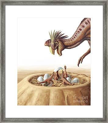 Oviraptor And Nest Framed Print by Spencer Sutton
