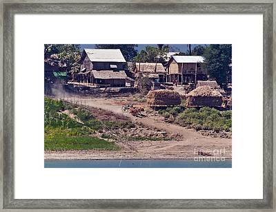 Oxcart Traveling Down A Dust Hill Framed Print by Beth Wolff