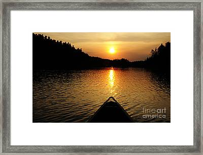 Paddling Off Into The Sunset Framed Print by Larry Ricker