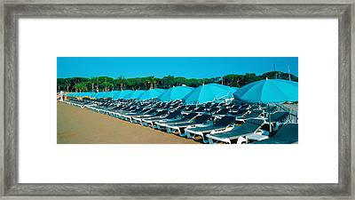 Parasols With Lounge Chairs Framed Print by Panoramic Images