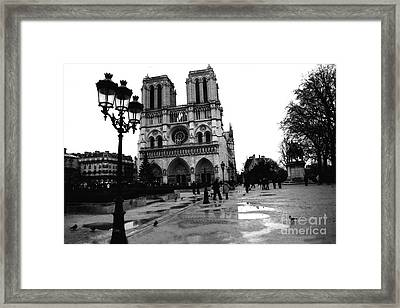 Paris Notre Dame Cathedral - Notre Dame Cathedral Courtyard Rainy Black And White Framed Print by Kathy Fornal