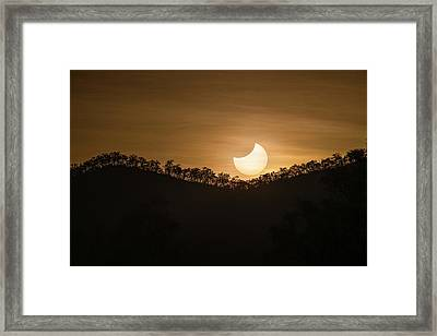 Partial Solar Eclipse Framed Print by Martin Rietze