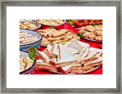 Party Food Framed Print by Tom Gowanlock