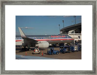 Passenger Airliner At An Airport Framed Print by Jim West