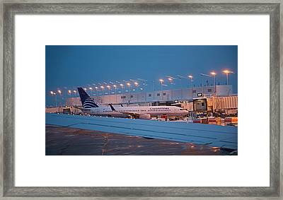 Passenger Airliner At Terminal Framed Print by Jim West