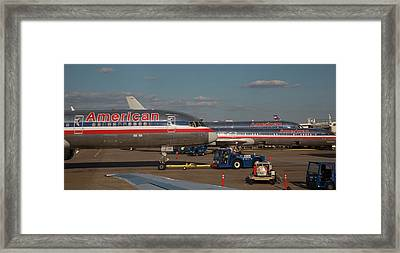 Passenger Airliners At An Airport Framed Print by Jim West