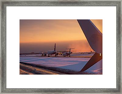 Passenger Airliners Taxiing At Dawn Framed Print by Jim West
