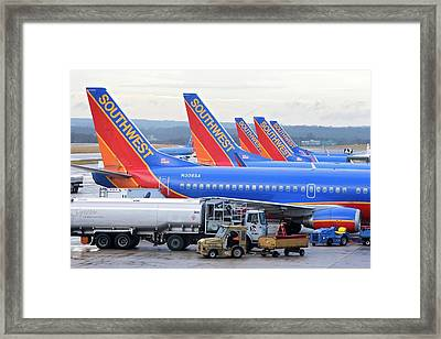 Passenger Jet Airliners At Airport Framed Print by Jim West