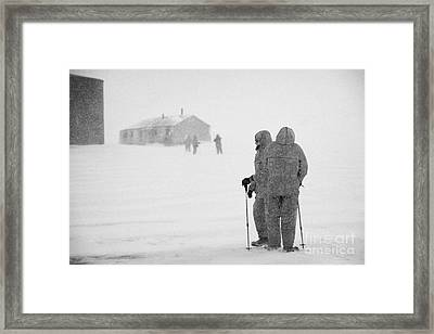 Passengers From Expedition Ship On Shore Excursion To Whaler's Bay Antarctica Framed Print by Joe Fox