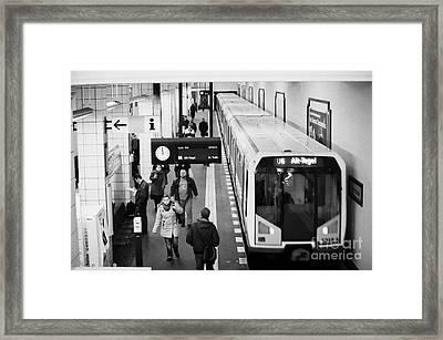 passengers on ubahn train platform as train leaves Friedrichstrasse u-bahn station Berlin Germany Framed Print by Joe Fox