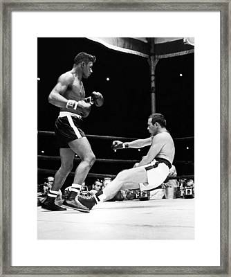 Patterson Knocks Out Johansson Framed Print by Underwood Archives