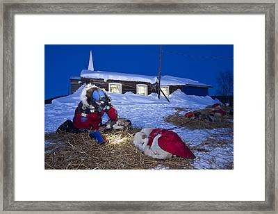 Paul Gebhart Boots His Dogs In Front Of Framed Print by Jeff Schultz