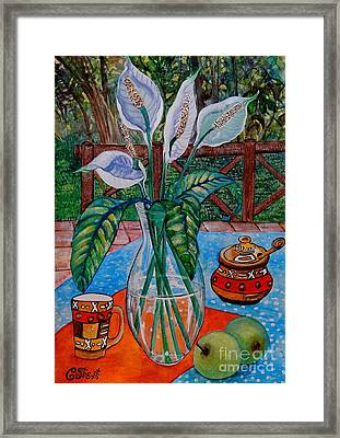 Peace Lilies On The Patio Framed Print by Caroline Street