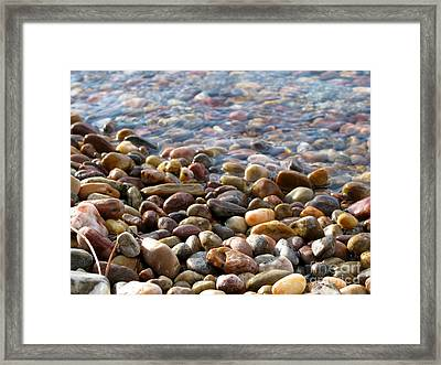 Pebbles On The Shore Framed Print by Leone Lund