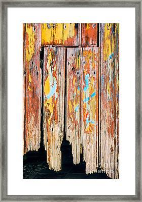 Peeling Door Framed Print by Carlos Caetano