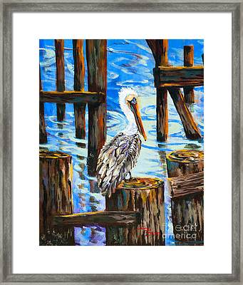 Pelican And Pilings Framed Print by Dianne Parks
