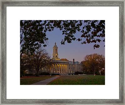 Penn State Old Main At Dusk Framed Print by William Ames