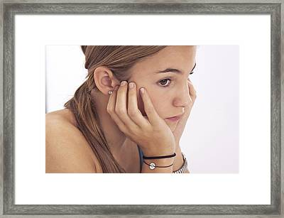 Pensive Teenage Girl Framed Print by Science Photo Library