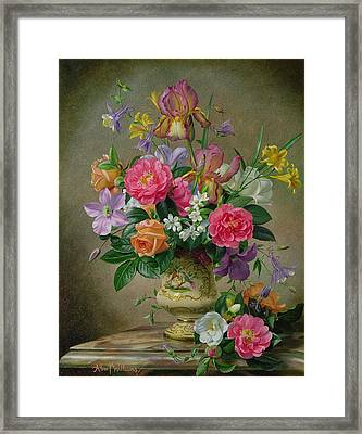 Peonies And Irises In A Ceramic Vase Framed Print by Albert Williams