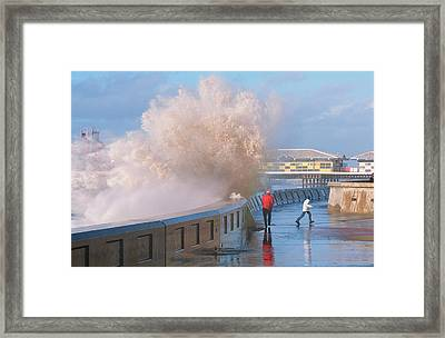 People Dodging Storm Waves Framed Print by Ashley Cooper