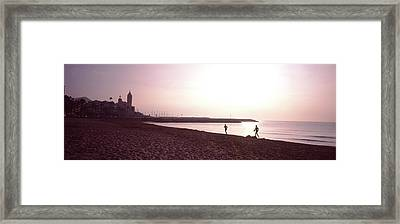 People Jogging On Beach, Sitges Framed Print by Panoramic Images