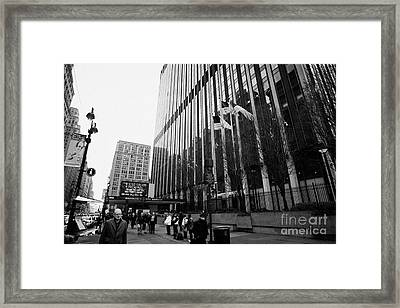 people on the sidewalk outside madison square garden with US flags flying new york city Framed Print by Joe Fox