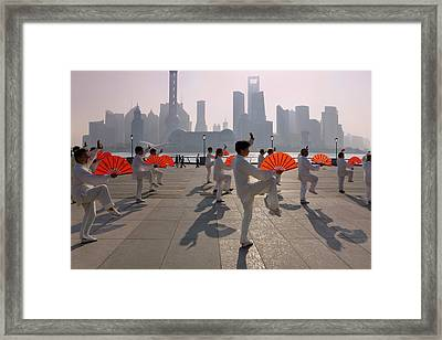People Practicing Taiji With Red Fans Framed Print by Keren Su