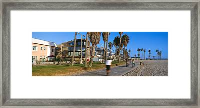 People Riding Bicycles Near A Beach Framed Print by Panoramic Images