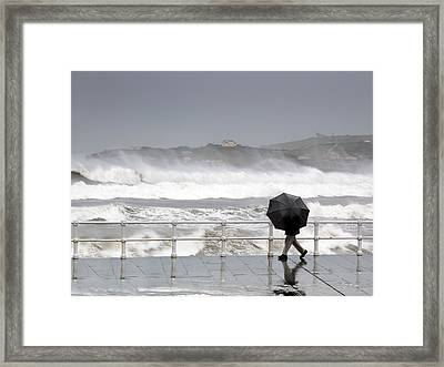 Person Protecting With Umbrella In A Rainy And Windy Day Framed Print by Mikel Martinez de Osaba