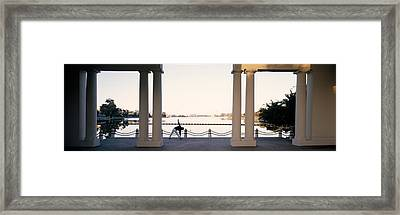 Person Stretching Near Colonnade, Lake Framed Print by Panoramic Images