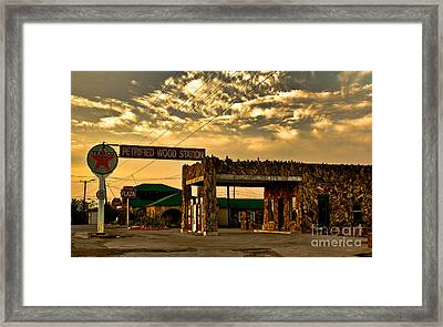 Petrified Gas Station After Rain Framed Print by Robert Frederick