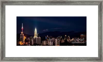 Petronas Lights Framed Print by Adrian Evans
