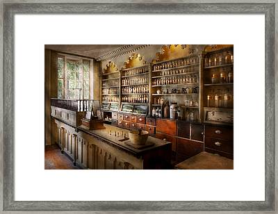 Pharmacist - The Dispensatory Framed Print by Mike Savad