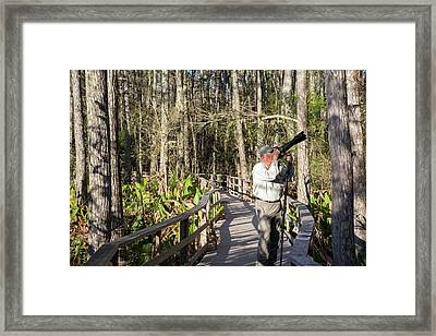 Photographer In A Nature Reserve Framed Print by Jim West