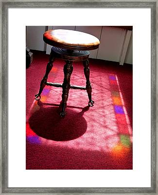 Piano Stool And Rainbow Light Framed Print by Jeff Lowe