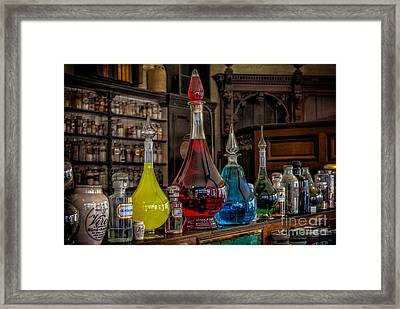 Pick An Elixir Framed Print by Adrian Evans
