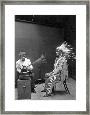 Piegan Chief Having Voice Recorded Framed Print by Underwood Archives