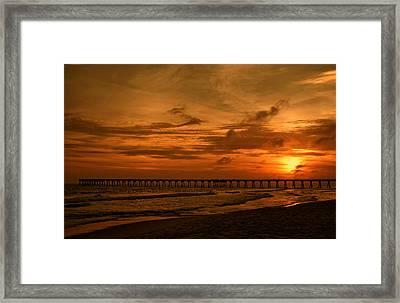 Pier At Sunset Framed Print by Sandy Keeton