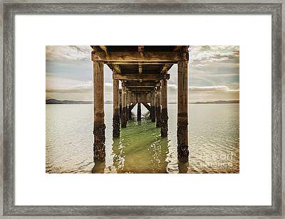 Pier Under Framed Print by Colin and Linda McKie