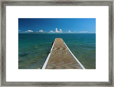 Pier With Cocos Island Framed Print by Michael Runkel