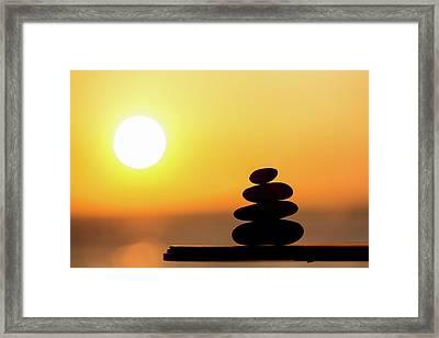 Pile Of Stone At Sunset Framed Print by Wladimir Bulgar