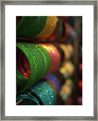 Piles Of Bangles Are Stacked Framed Print by David H. Wells