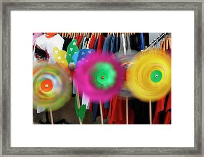 Pinwheels Rotating In Breeze, Southern Framed Print by Adam Jones