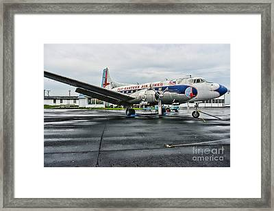 Plane On The Tarmac Framed Print by Paul Ward