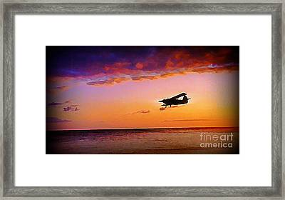 Plane Pass At Sunset Framed Print by John Malone